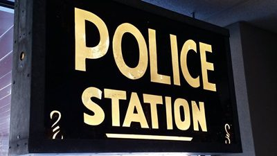 Painted and Lighted Police Sign